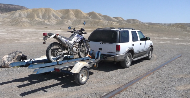 Three-track motorcycle trailer can carry up to three bikes at a time.