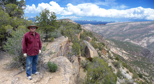 Gunnison Gorge overlook. That's Woody. I used PhotoShop Essentials 6 to bring out the clouds a bit.