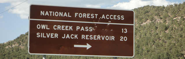 Sign on US Hwy 550 northbound that shows direction to Owl Creek Pass