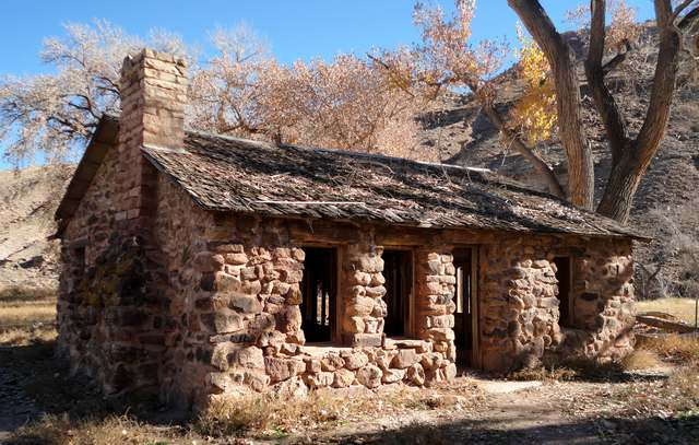 The Walker Cabin. See the text for the inscription on the placard out front. The home is owned by the Colorado Division of Wildlife and is open to the public. Please, please, do not tear more lathe and plaster off the walls.