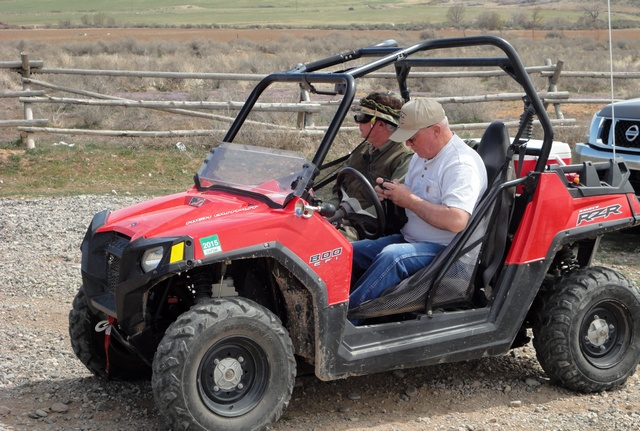 Gary at the wheel of his Polaris RZR, with passenger Bob along for the ride.