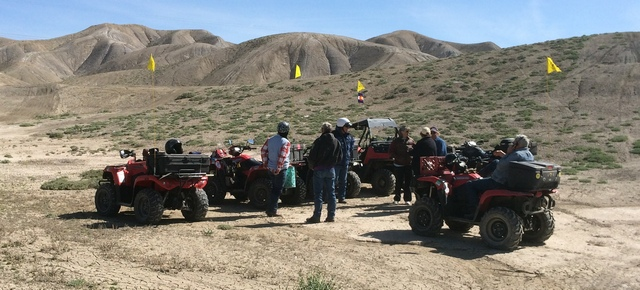 The group stops for lunch north of Flat Top. Note the adobe hills in the background. The entire area is composed of this soft dirt that supports very little vegetation. The feds and the City of Montrose  have set aside a few thousand acres of this as a free-riding area.
