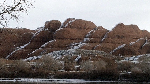 Moab, Potash Road: Some large rock formations across the river. I like the way the snow caps line up.