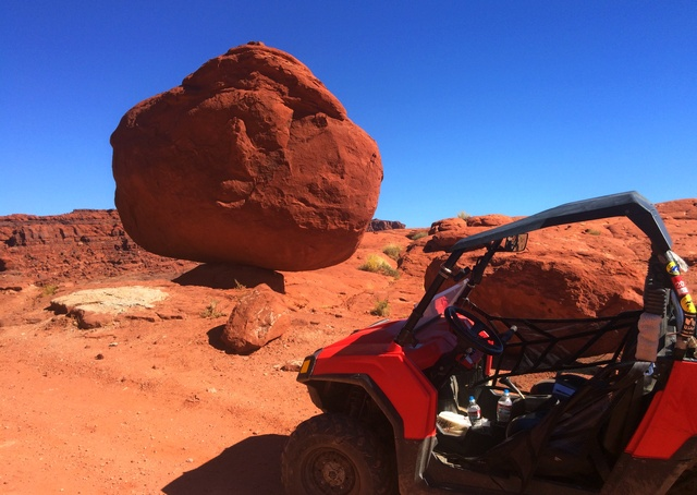 That rock is balancing on that tiny little spot. The rock is bigger than the Polaris RZR. I know that it likely won't roll away for a century or two, but I stayed well away from it!